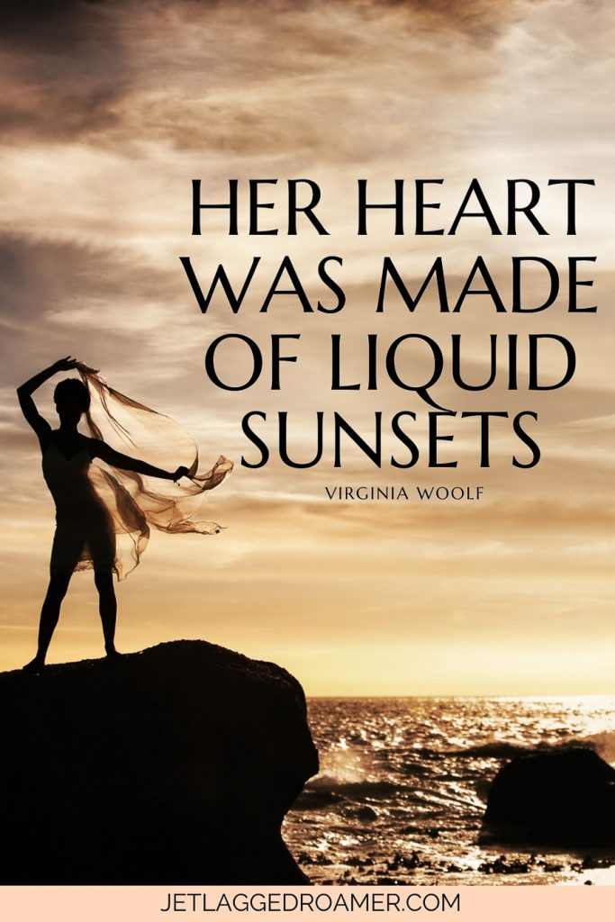 """Text reads """"Her heart was made of liquid sunsets."""" — Virginia Woolf. Woman on a boulder at the beach posing during sunset."""