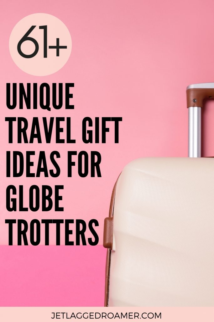 GIFTS FOR TRAVEL LOVERS PINTEREST PEN. TAX RATE 61+ UNIQUE TRAVEL GIFT IDEAS FOR GLOBETROTTERS. IMAGE OF A CREAM CARRY-ON SUITCASE AGAINST A PINK BACKGROUND.