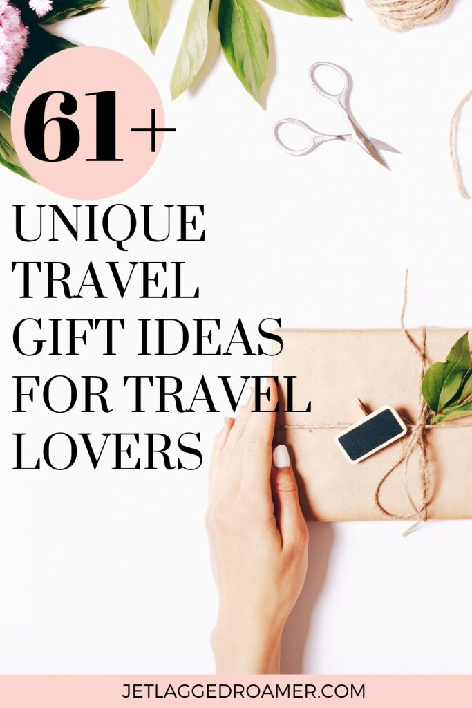 GIFT IDEAS FOR TRAVEL LOVERS PINTEREST PIN. TEXT READ 61+ UNIQUE TRAVEL GIFT IDEAS FOR TRAVEL LOVERS. WOMAN HOLDING A GIFT WRAPPED IN A BROWN PAPER BAG.
