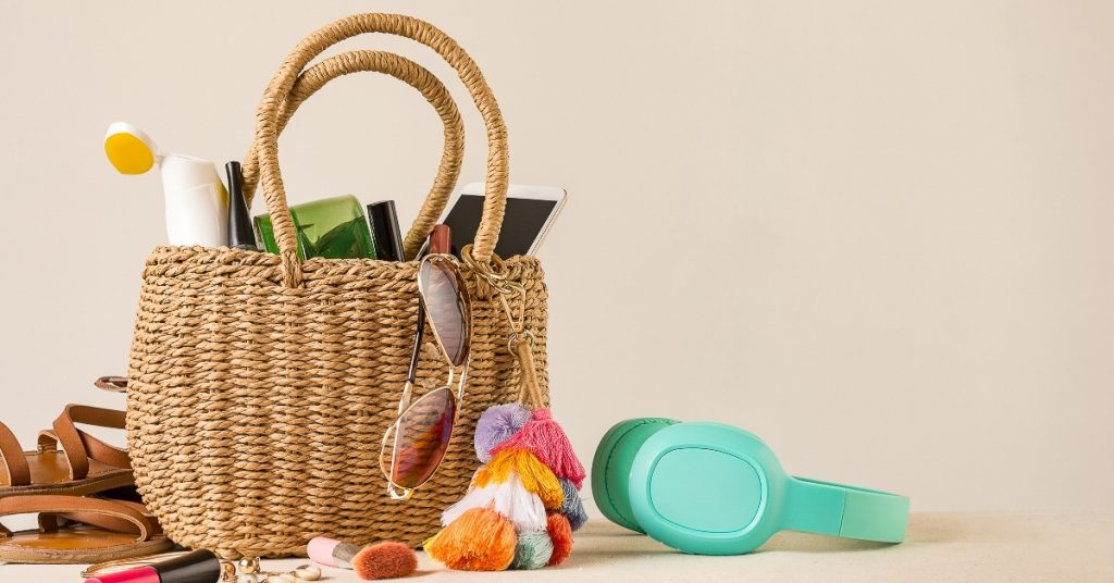 Straw beach bag with essentials to pack for the beaches in Florida
