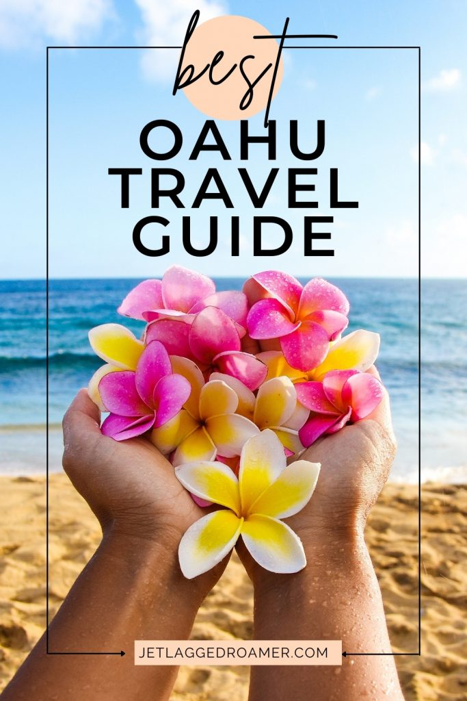 Ley in hands at the beach. Text says best Oahu travel guide.