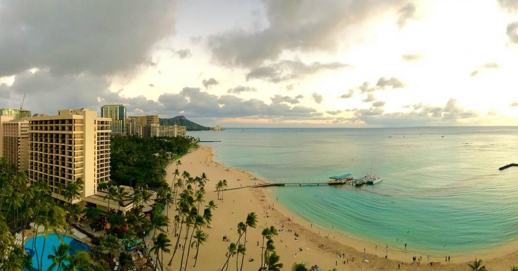 Hawaii captions picture of Waikiki beach during sunset.