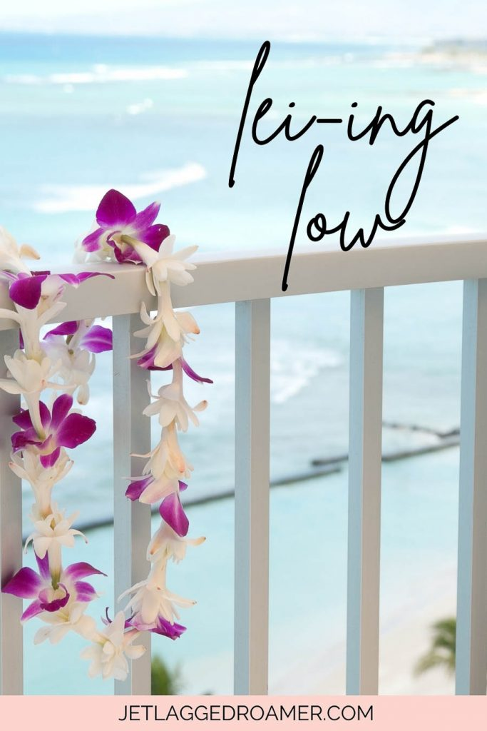 Hawaii pun that says lei-ing low. Beach with a lei.