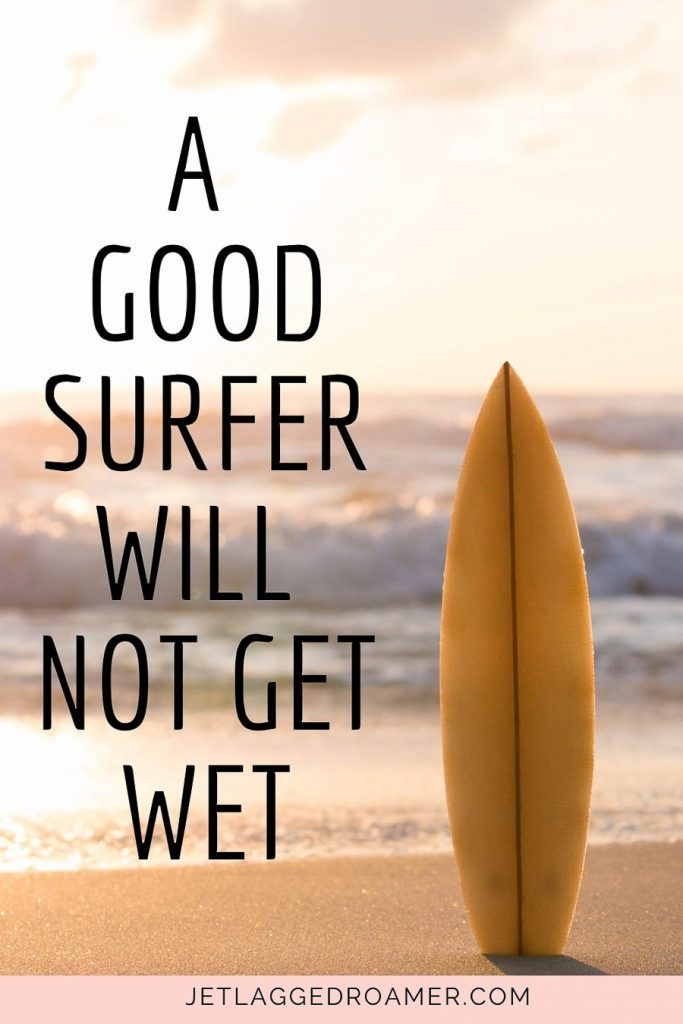 Surfboard on the beach and a Hawaiian proverb that reads A good surfer will not get wet.
