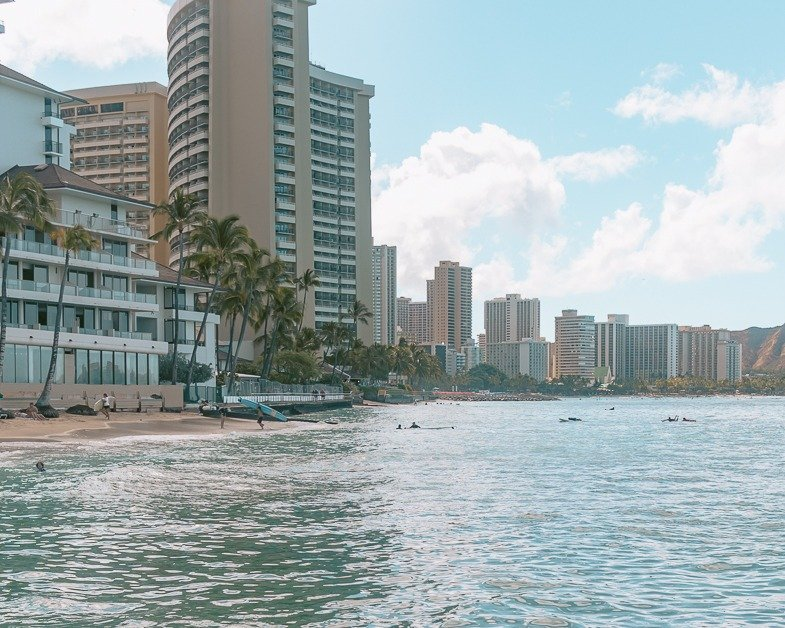 Waikiki beach on a sunny day. It's one of the top places to visit in Honolulu.