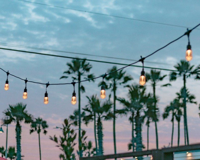 Hanging lights and a Los Angeles sunset.